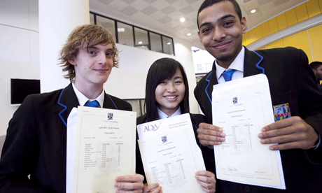 Students Joe Martin, Sweet Lordson and Jabedur Rahman with their GCSE results