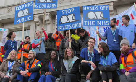 Protest: Junior doctors and artist Stik (centre) outside Hackney Town Hall. Photograph: Stik